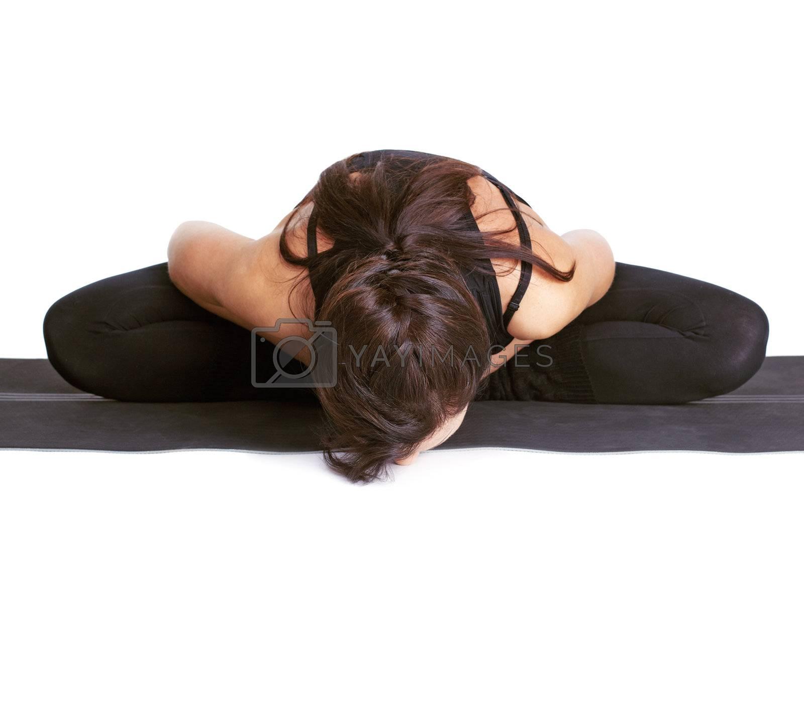 full-length portrait of beautiful woman working out yoga exercises badhakonasana on fitness mat