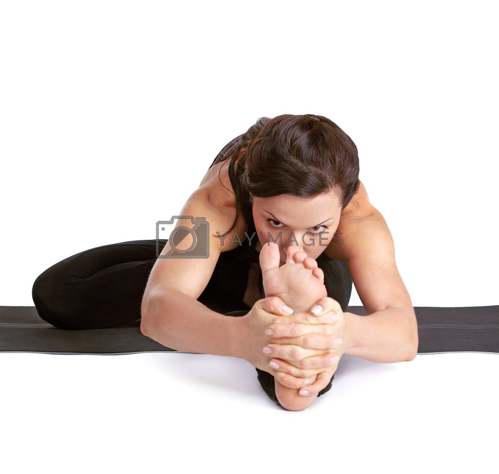 full-length portrait of beautiful woman working out yoga exercises Janu shirshasana pose on fitness mat
