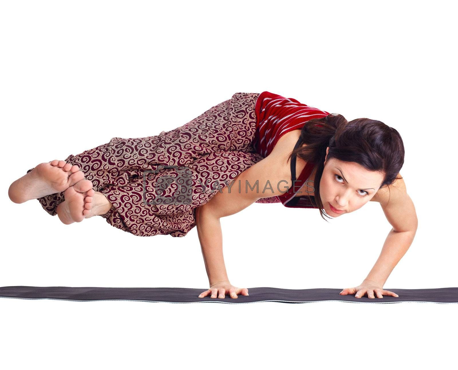 full-length portrait of beautiful woman working out yoga exercise balancing on hands in ashtavakrasana pose