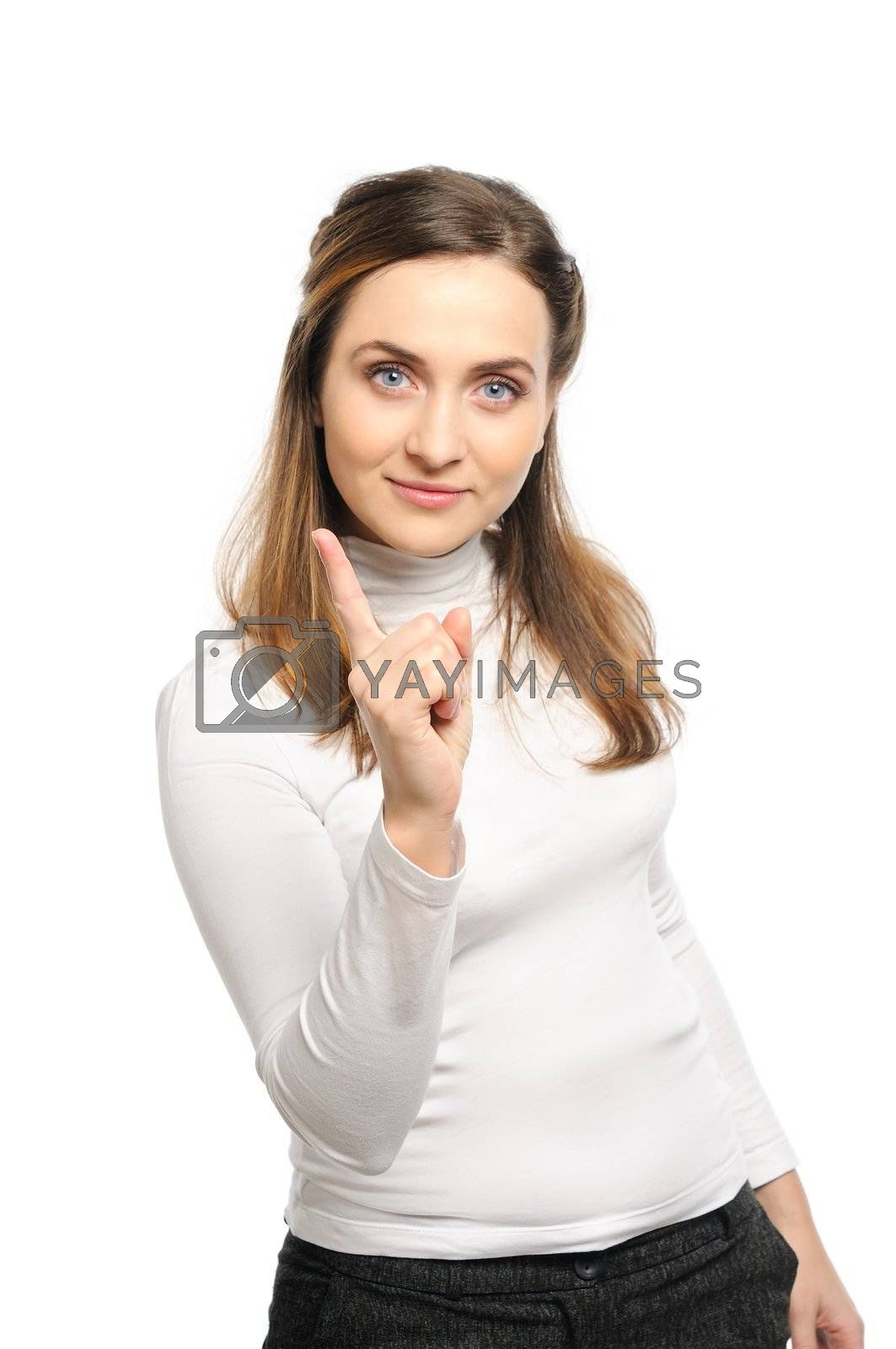 Beautiful young woman stands shaking finger.