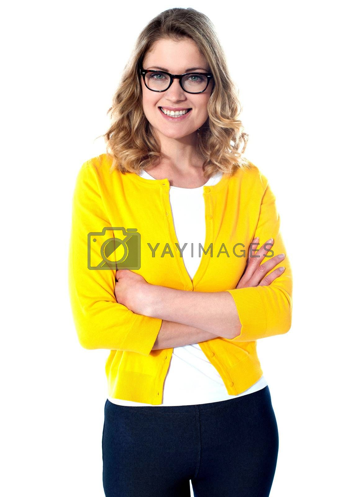 Pretty caucasian girl posing with arms crossed isolated on white