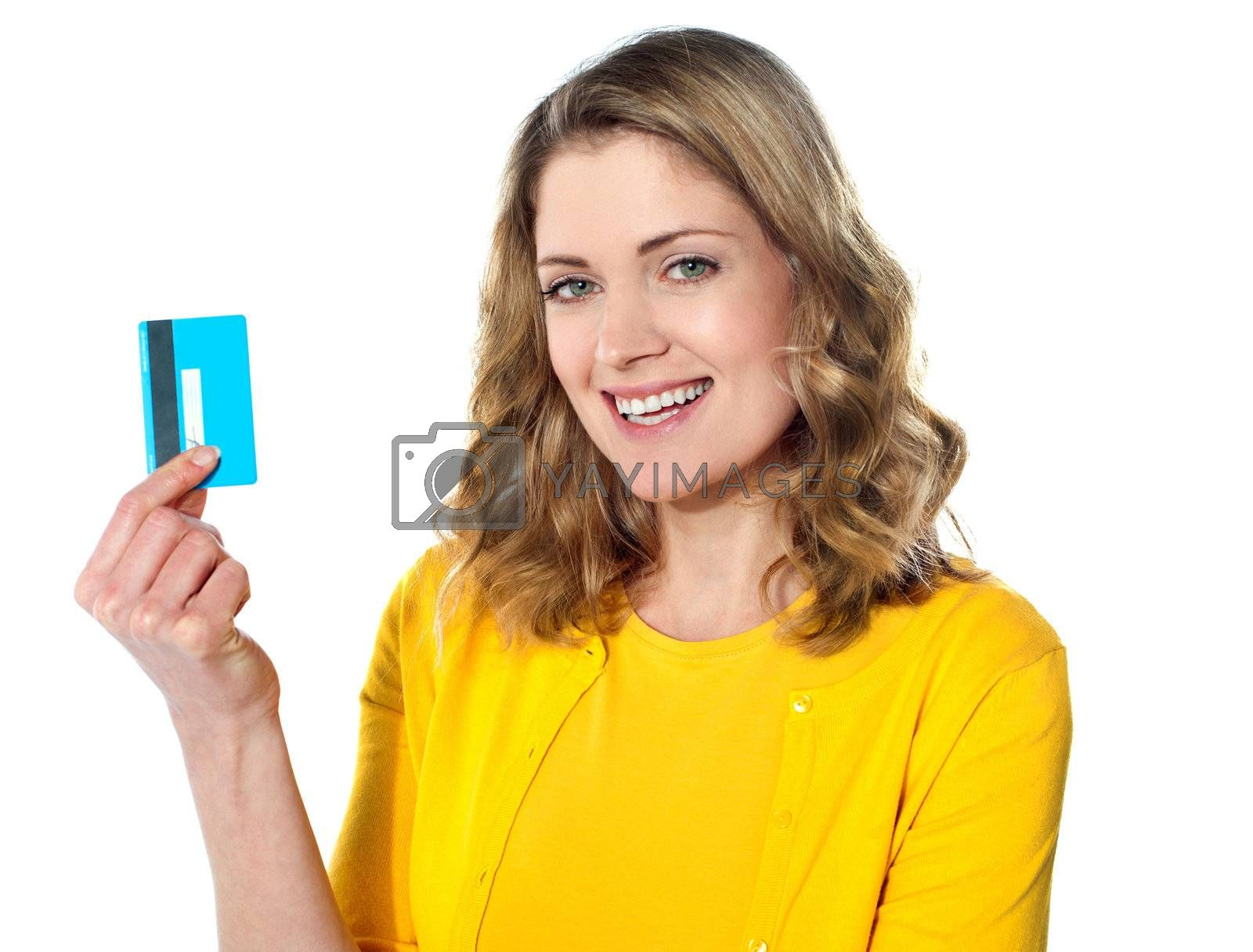 Close-up portrait of young smiling businesswoman holding credit card isolated on white background