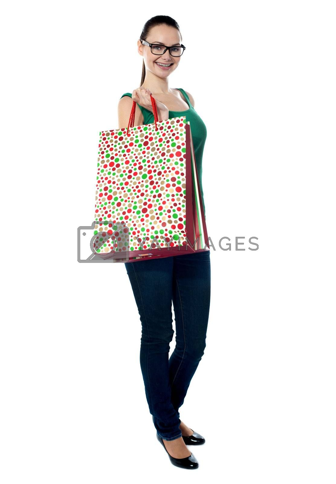 Stunning young woman carrying shopping bags