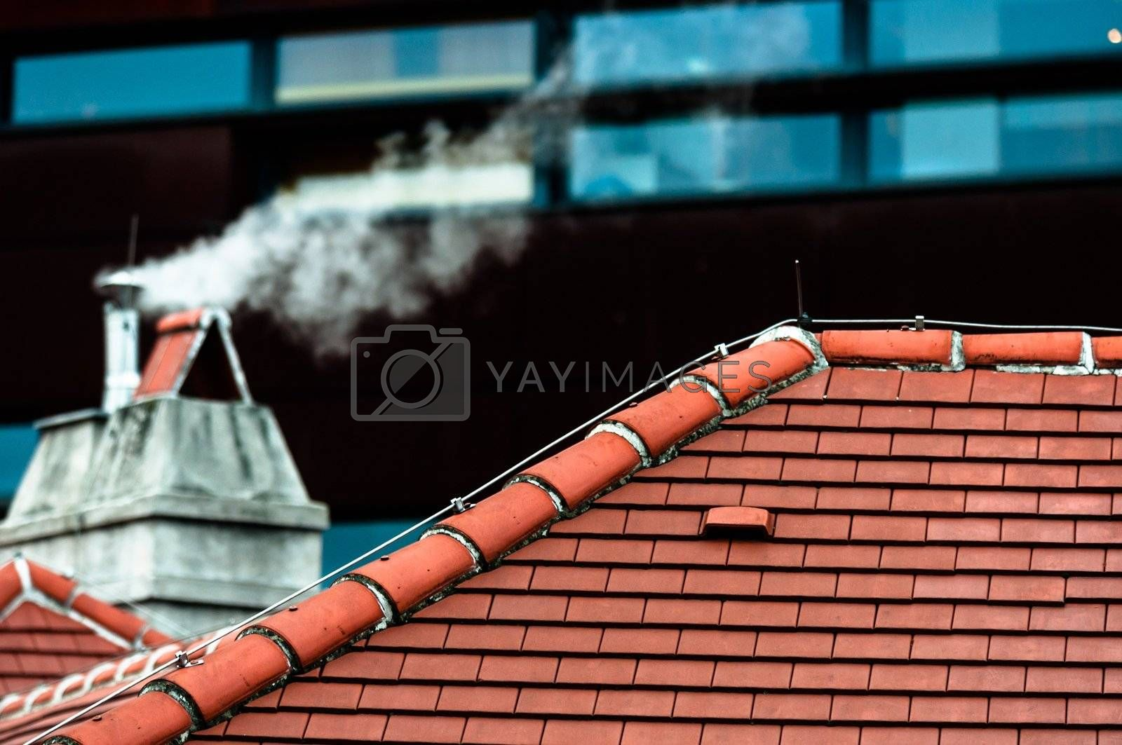 Small chimney with smoke of a house