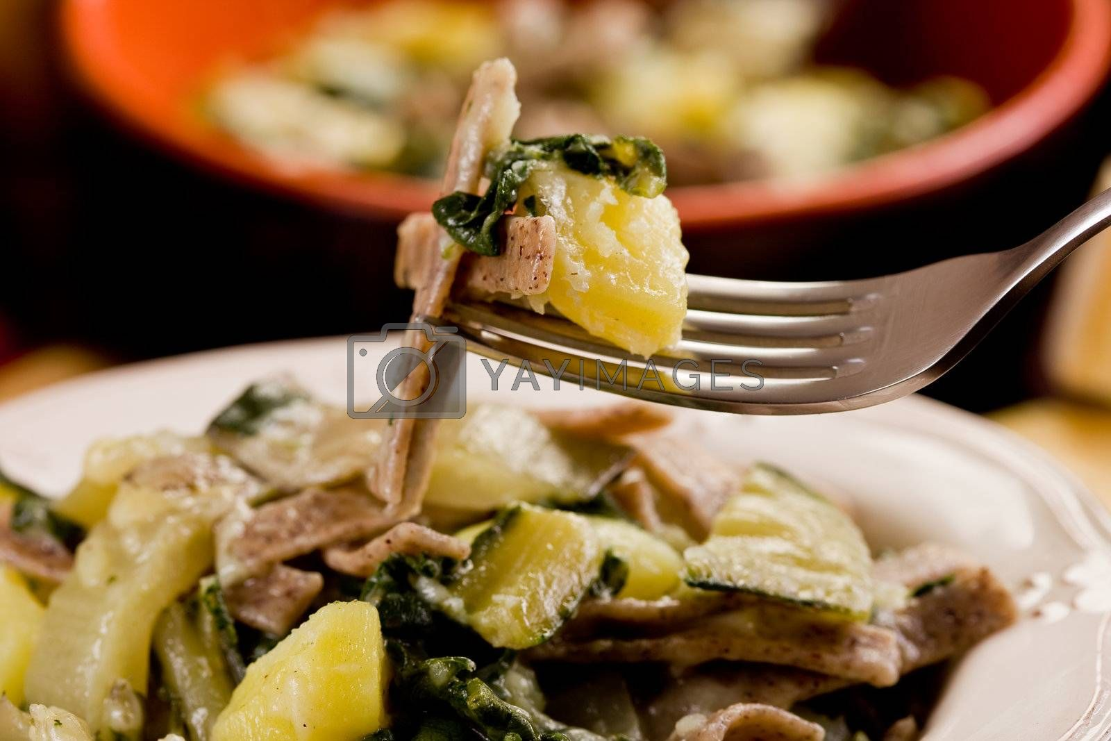 North Italian Regional pasta dish called pizzoccheri on wooden table