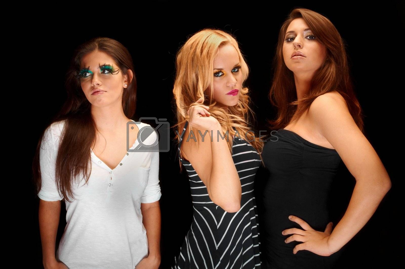 A group of young models against dark background a the studio