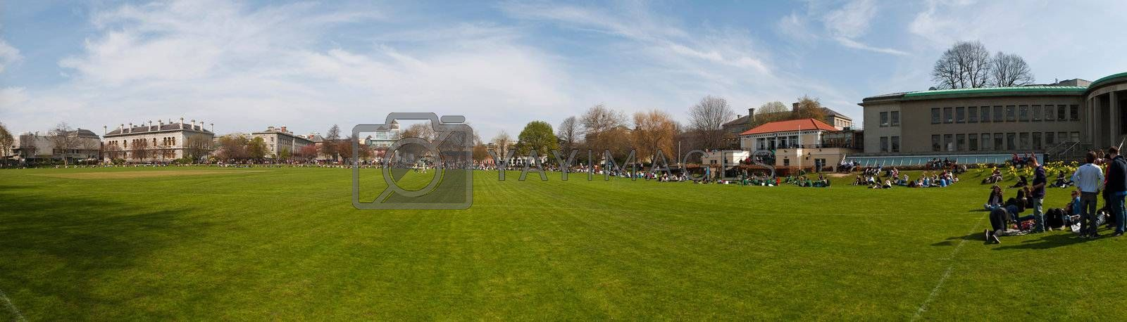 DUBLIN, IRELAND - MARCH 29: students enjoying outdoors at the cricket field in the Trinity College on March 29, 2012 in Dublin, Ireland.Ranked in 2011 by The Times as the 117th world's best university
