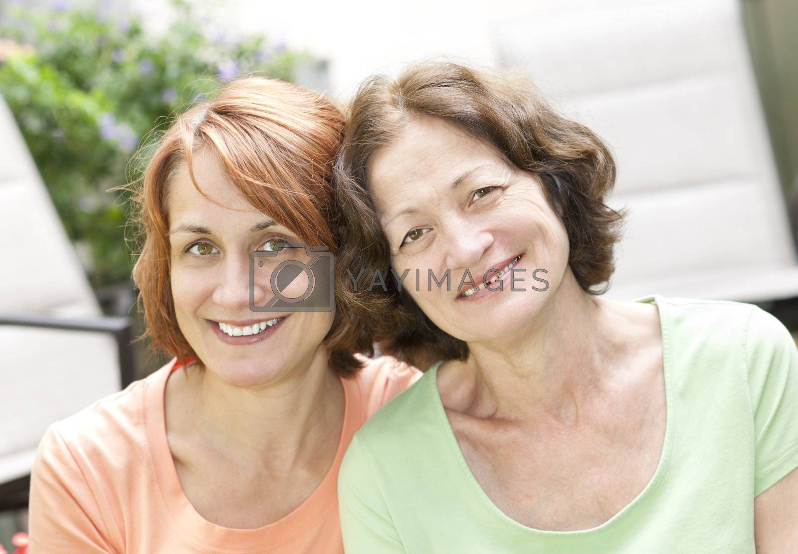 Family portrait of smiling mature mother and daughter