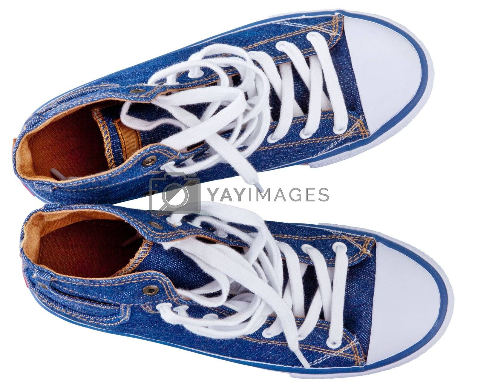 pair of simple gumshoes ( sneakers ) of denim canvas  on a white background