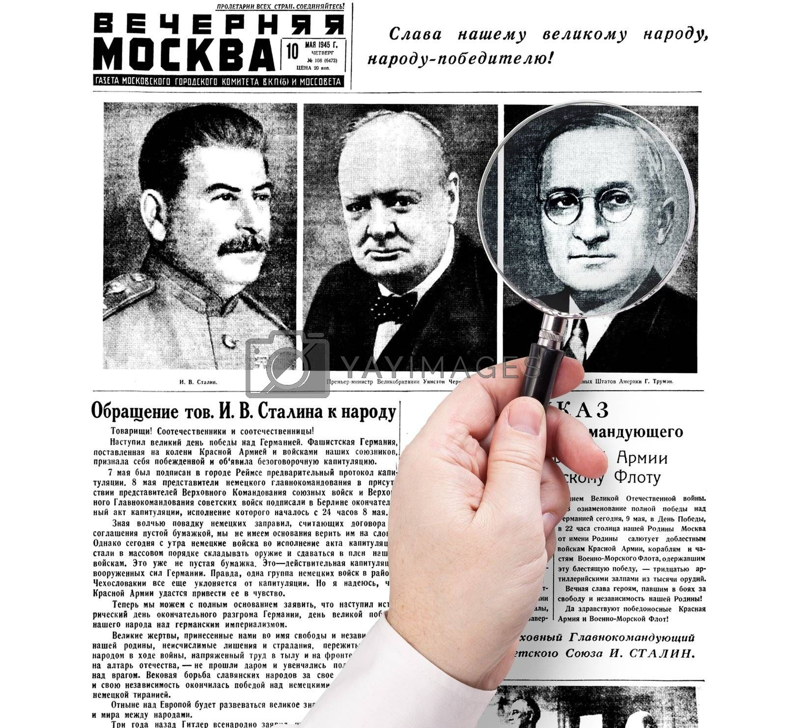 "hand with magnifying glass stuck on the newspaper ""Evening Moscow"", released May 10, 1945."