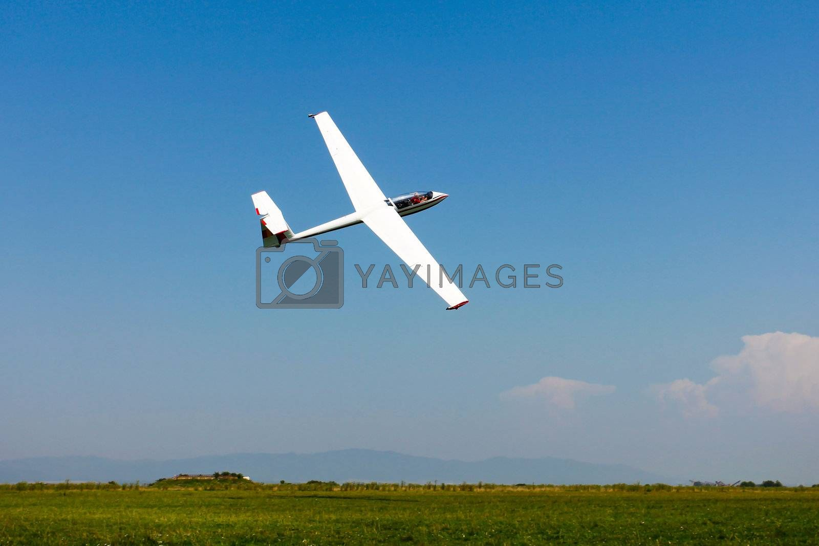 Glider flying on a blue sky