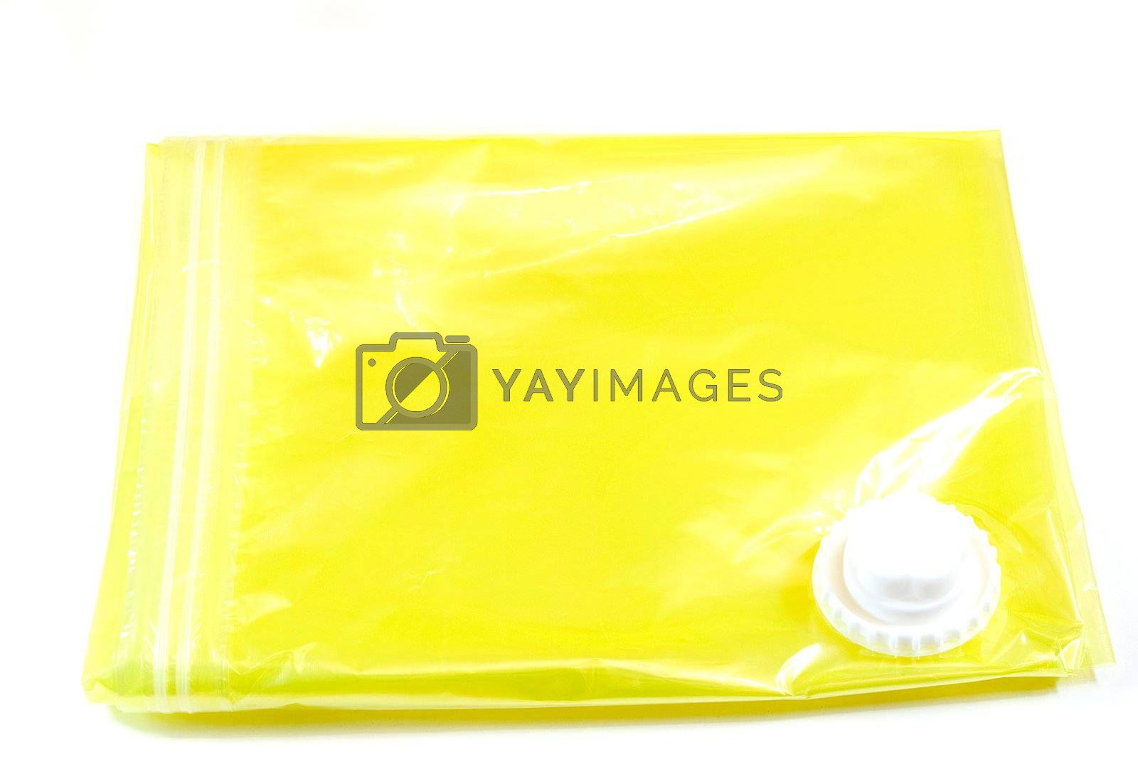 yellow vacuum storage clothes bag isolated on white