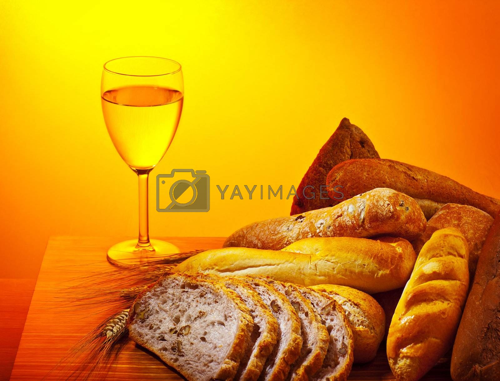 Holy supper, communion dinner, bread and glass of wine, Sunday christian traditional food, celebrating religious holidays