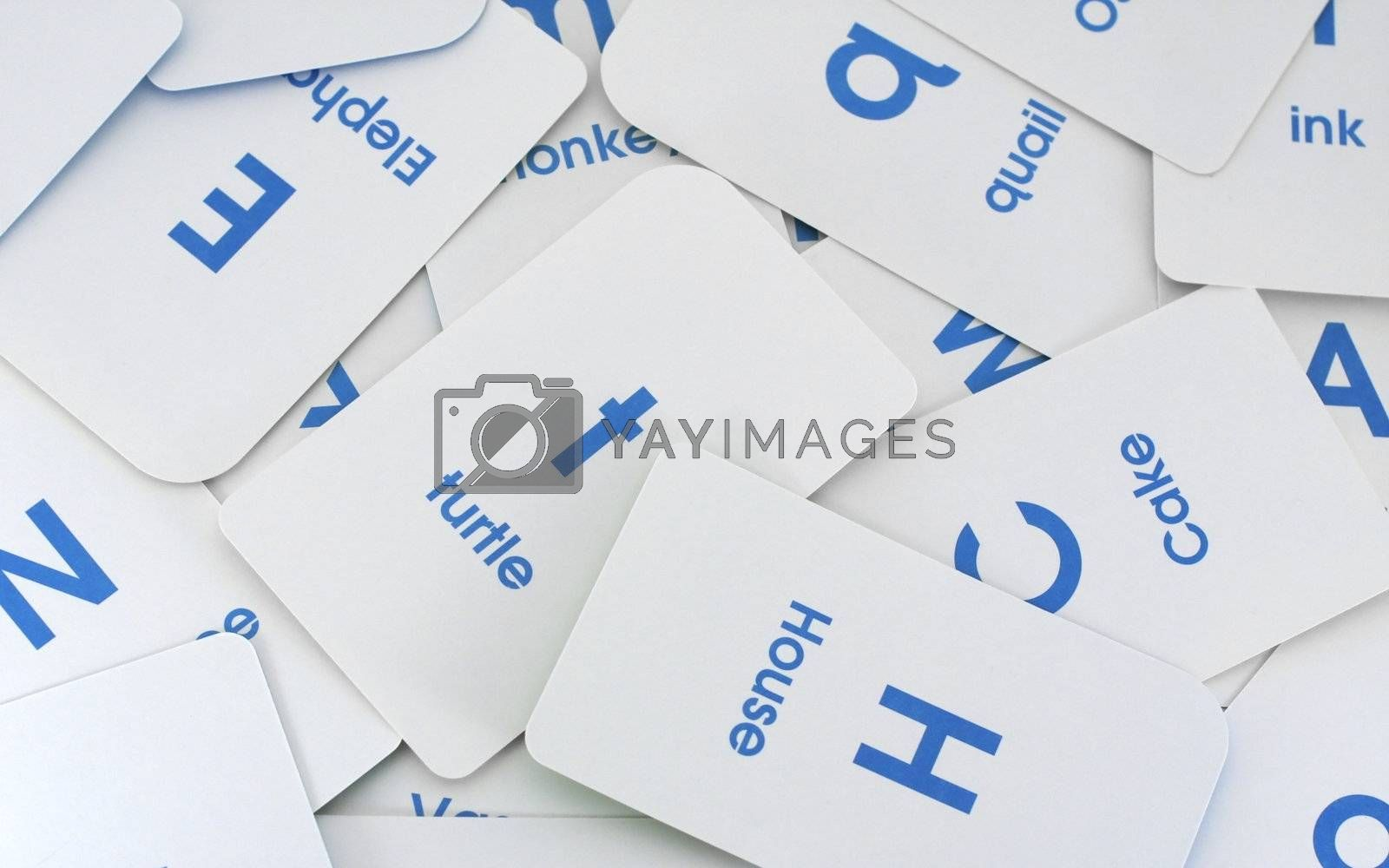 Letter and word flash cards create this background