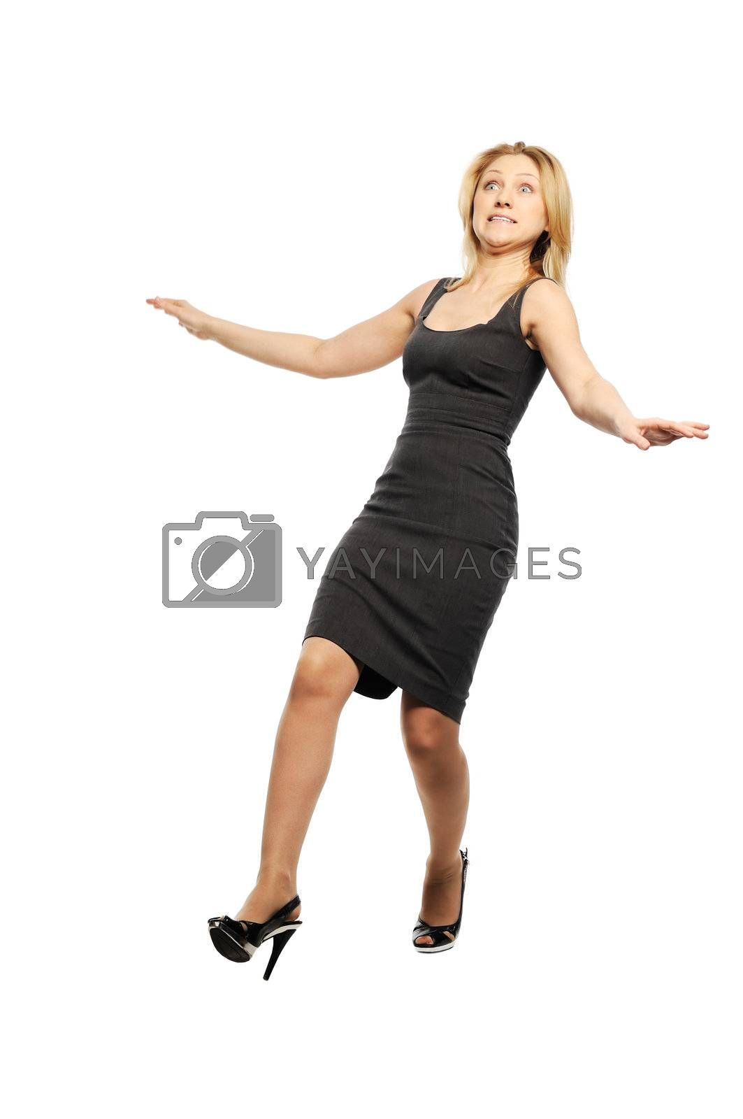 Beautiful young woman stands with falling back pose