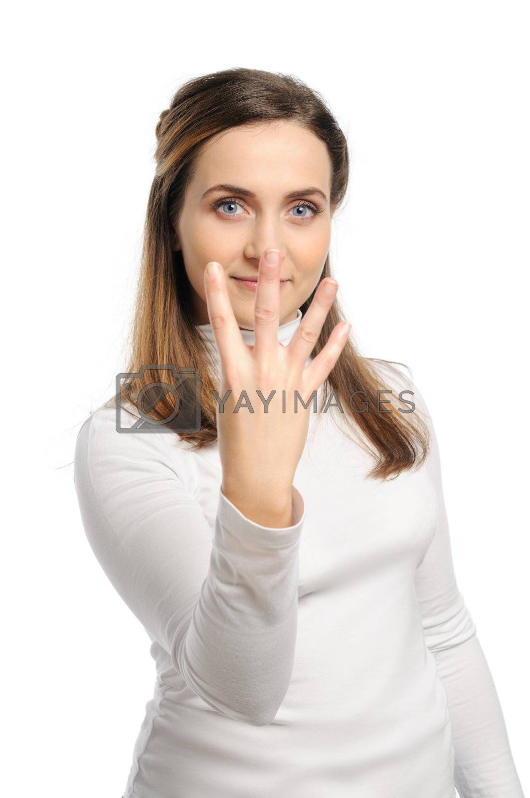 Young attractive girl shows gesture of the figure four. Isolated on white.