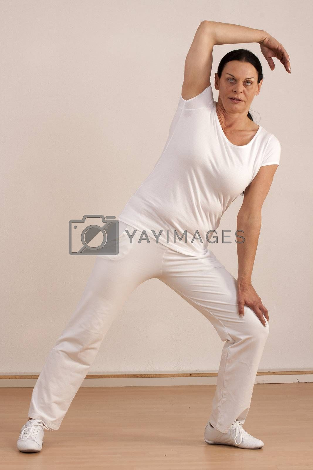Woman over forty does gymnastics