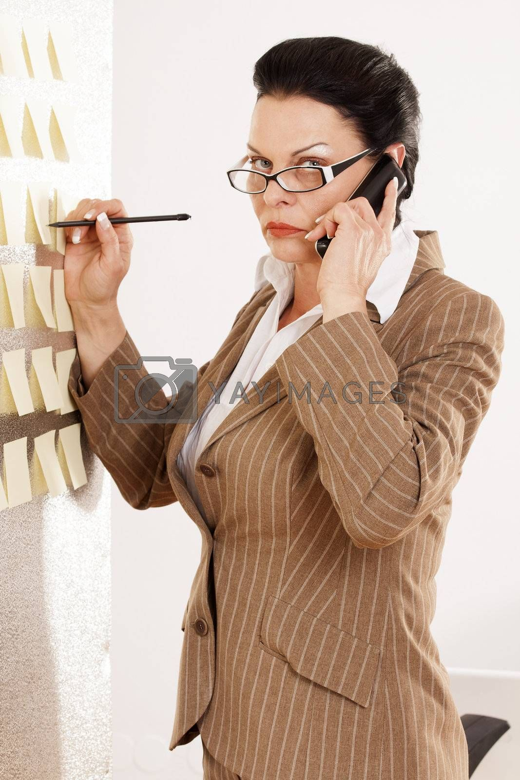 Woman writes to a wall on memos and phone calls