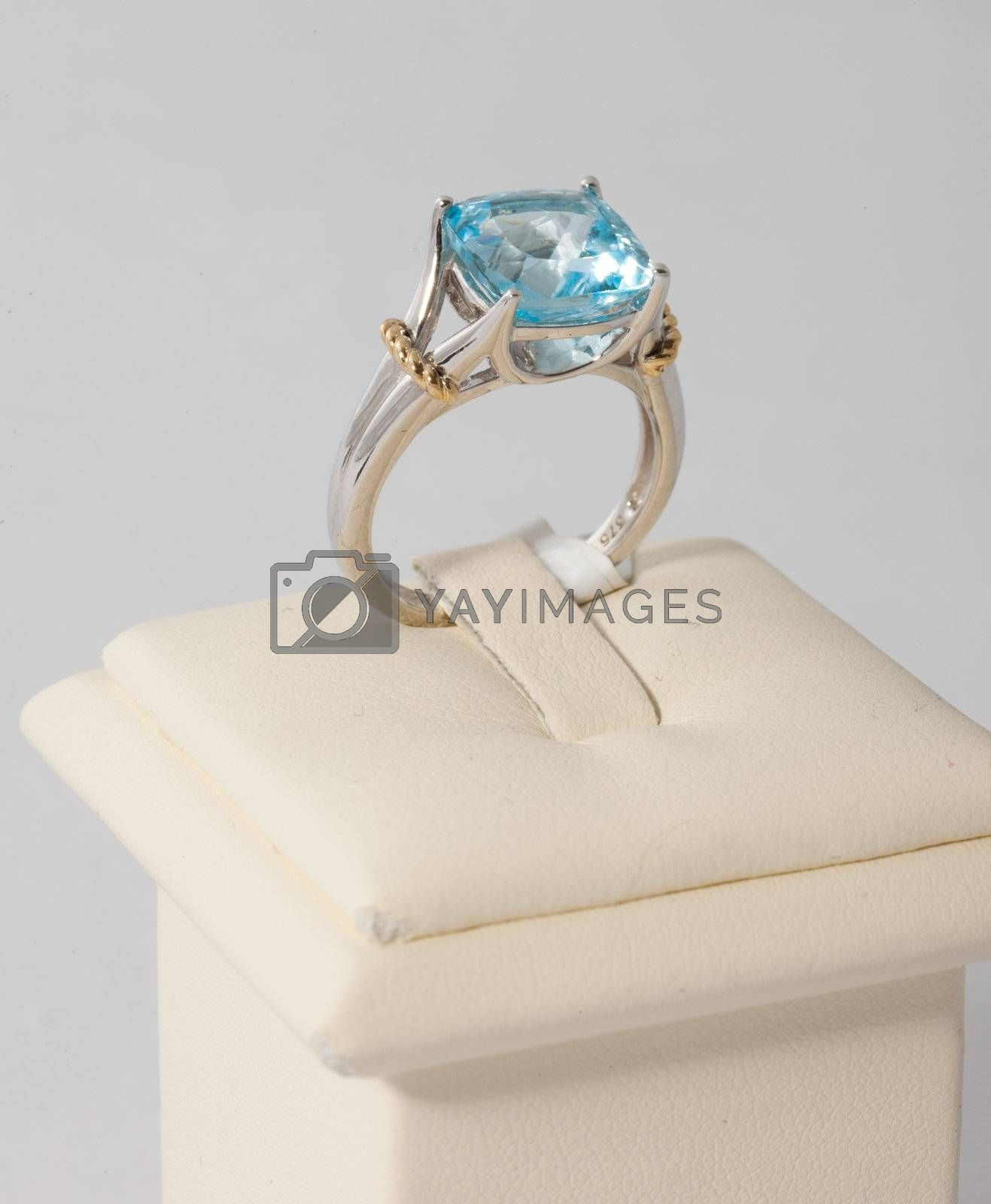 Ring with blue stone on display stand