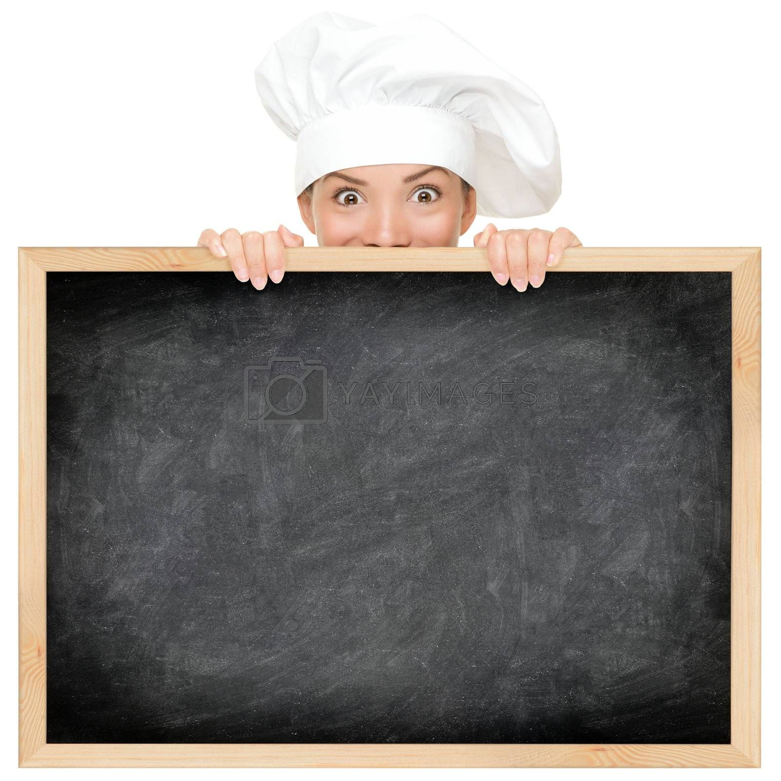 Chef showing restaurant menu blackboard - empty blank with copy space for text etc. Funny woman cook peeking over sign. Beautiful happy smiling mixed race Caucasian / Asian female model. Isolated on white background.