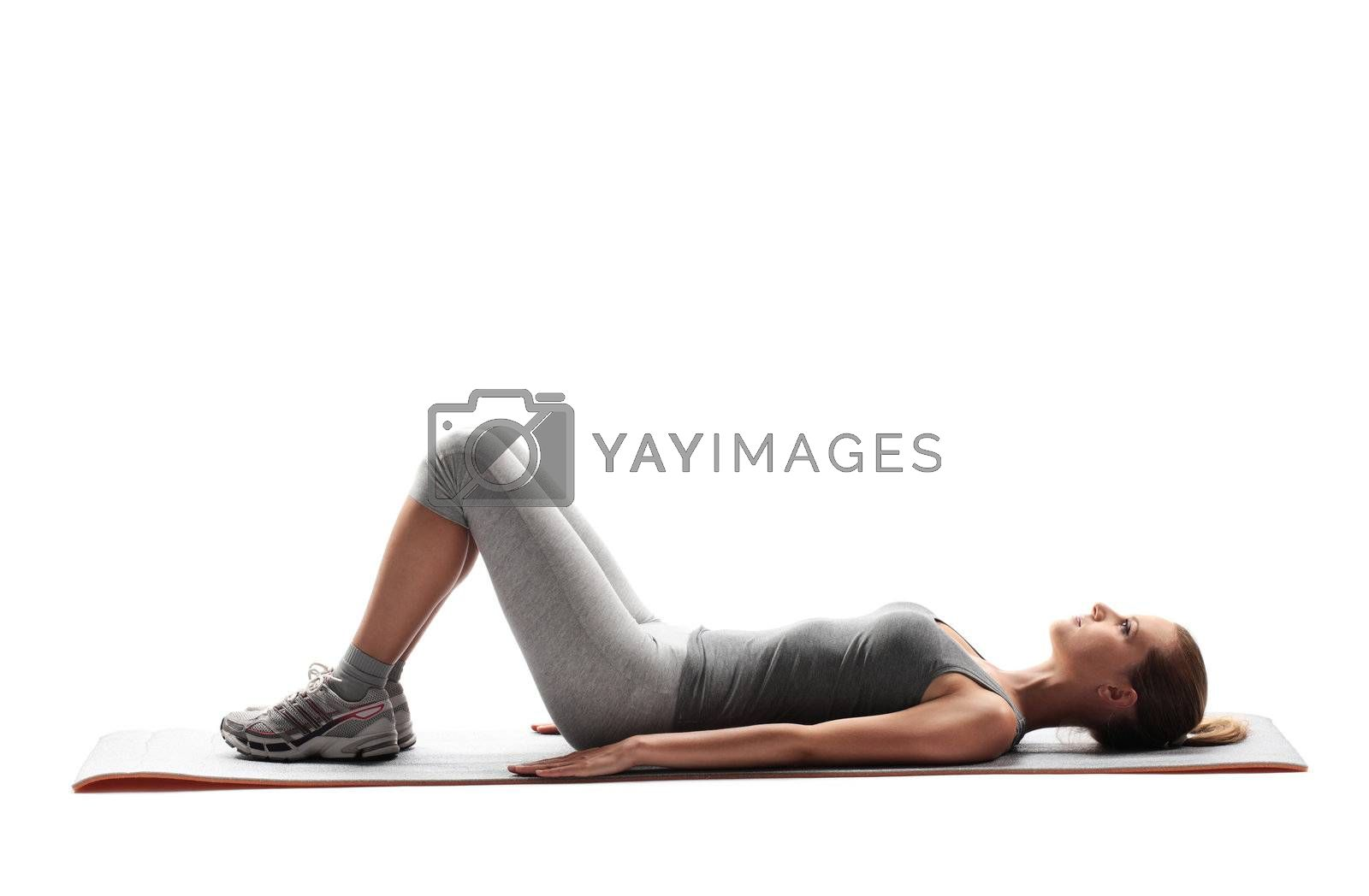 Portrait of a young healthy woman fitness abdominal exercises