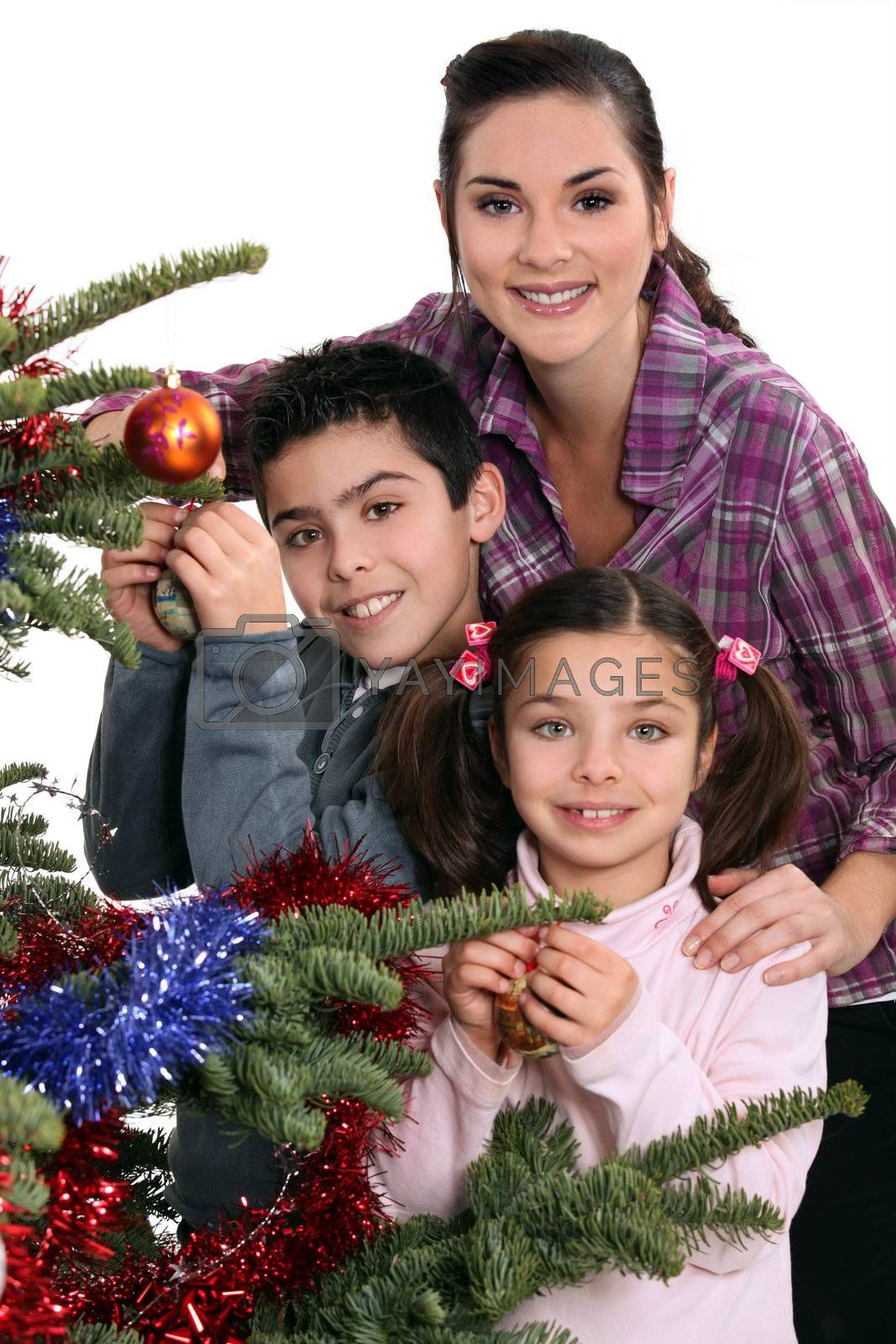 Family celebrating Christmas together by phovoir