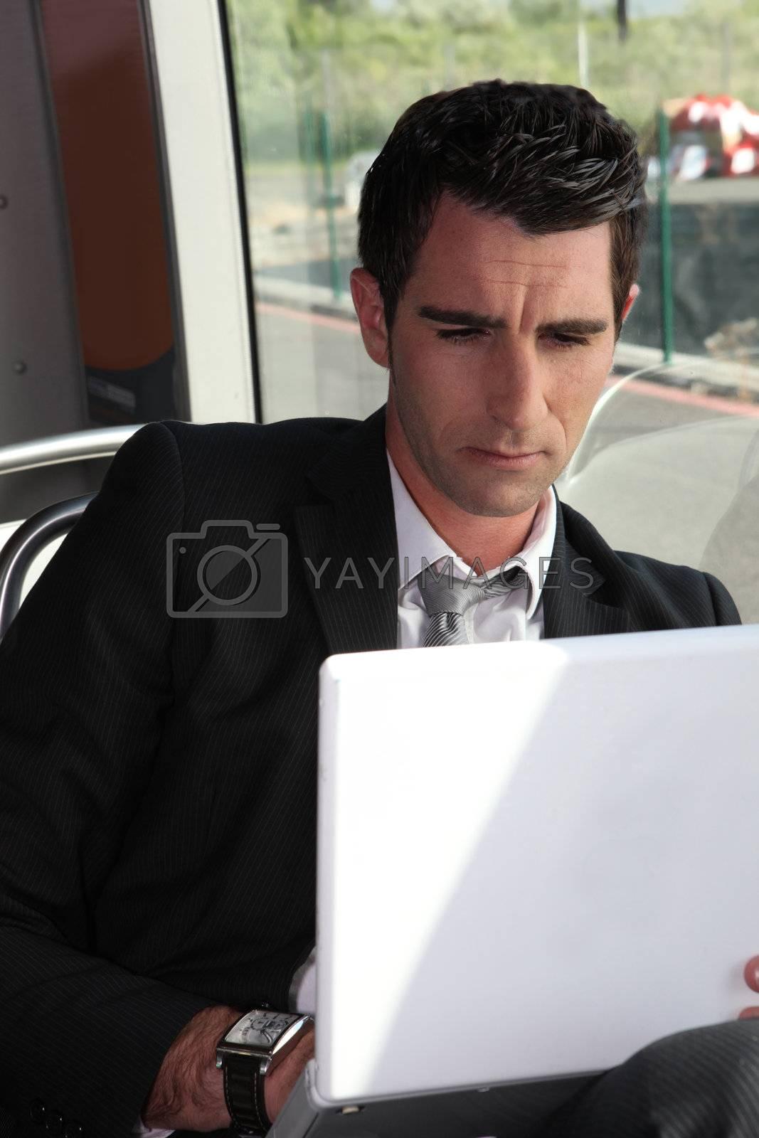 portrait of a man in public transportation by phovoir