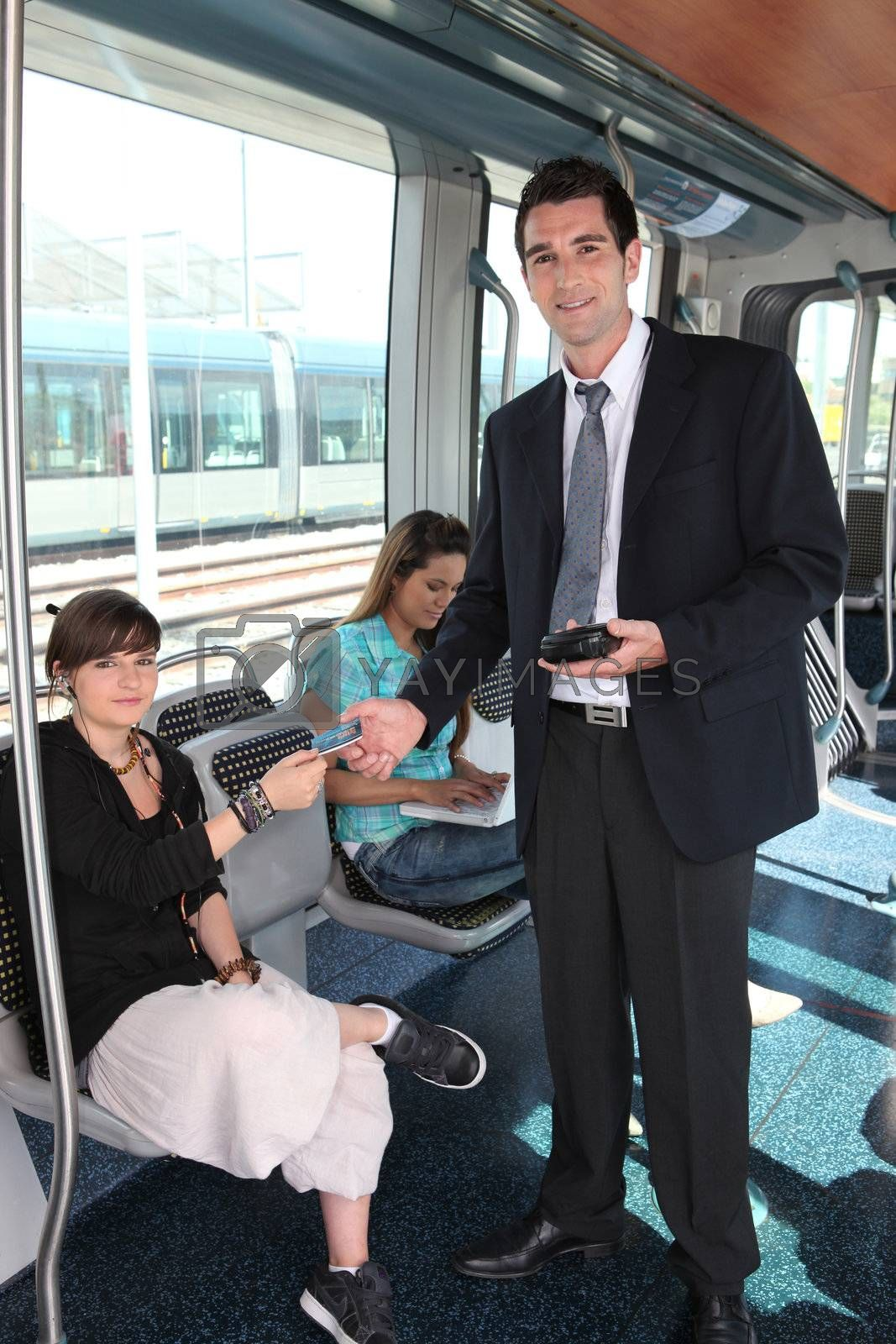 Man checking tram tickets