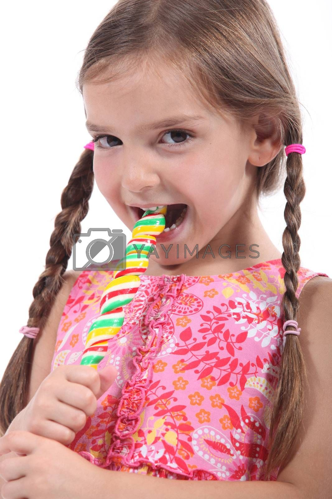 little girl with plaits sucking lollipop