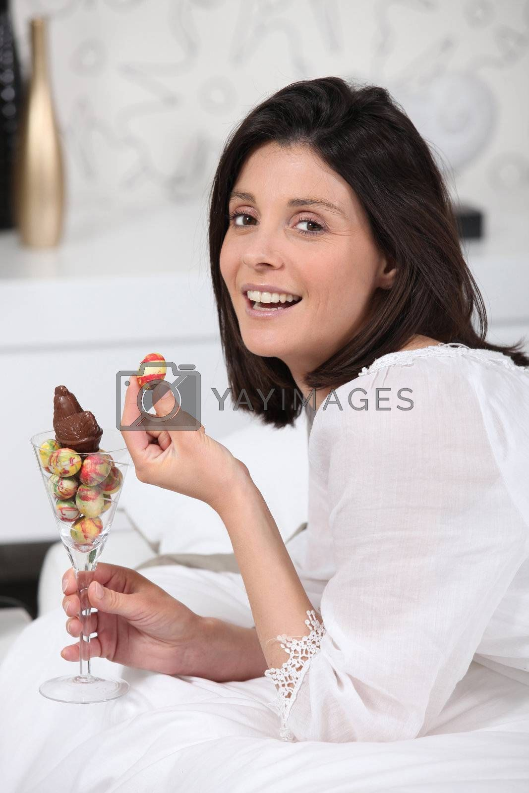 Woman eating Easter chocolate