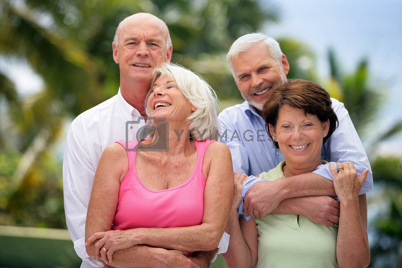 Two senior couples in the garden