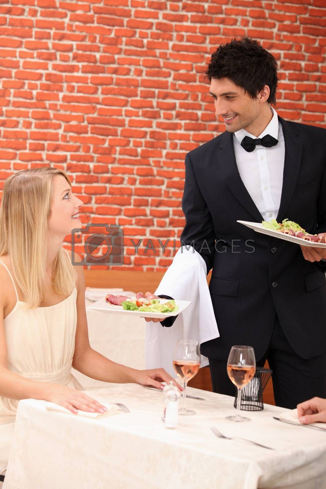Waiter serving lunch