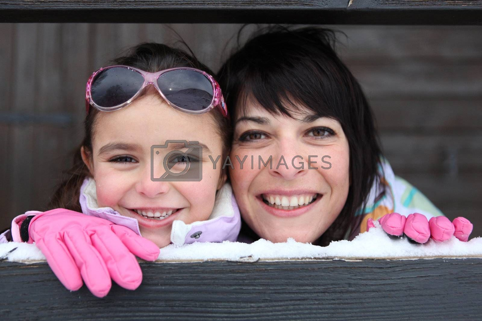 Mother and daughter playing snow by phovoir