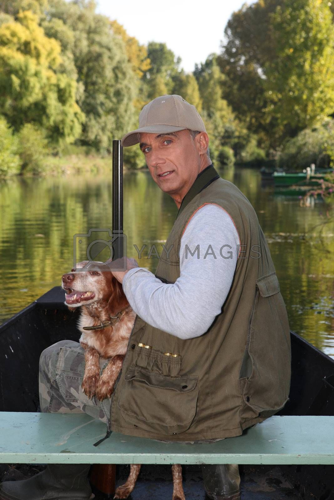 Hunter on a boat with his dog