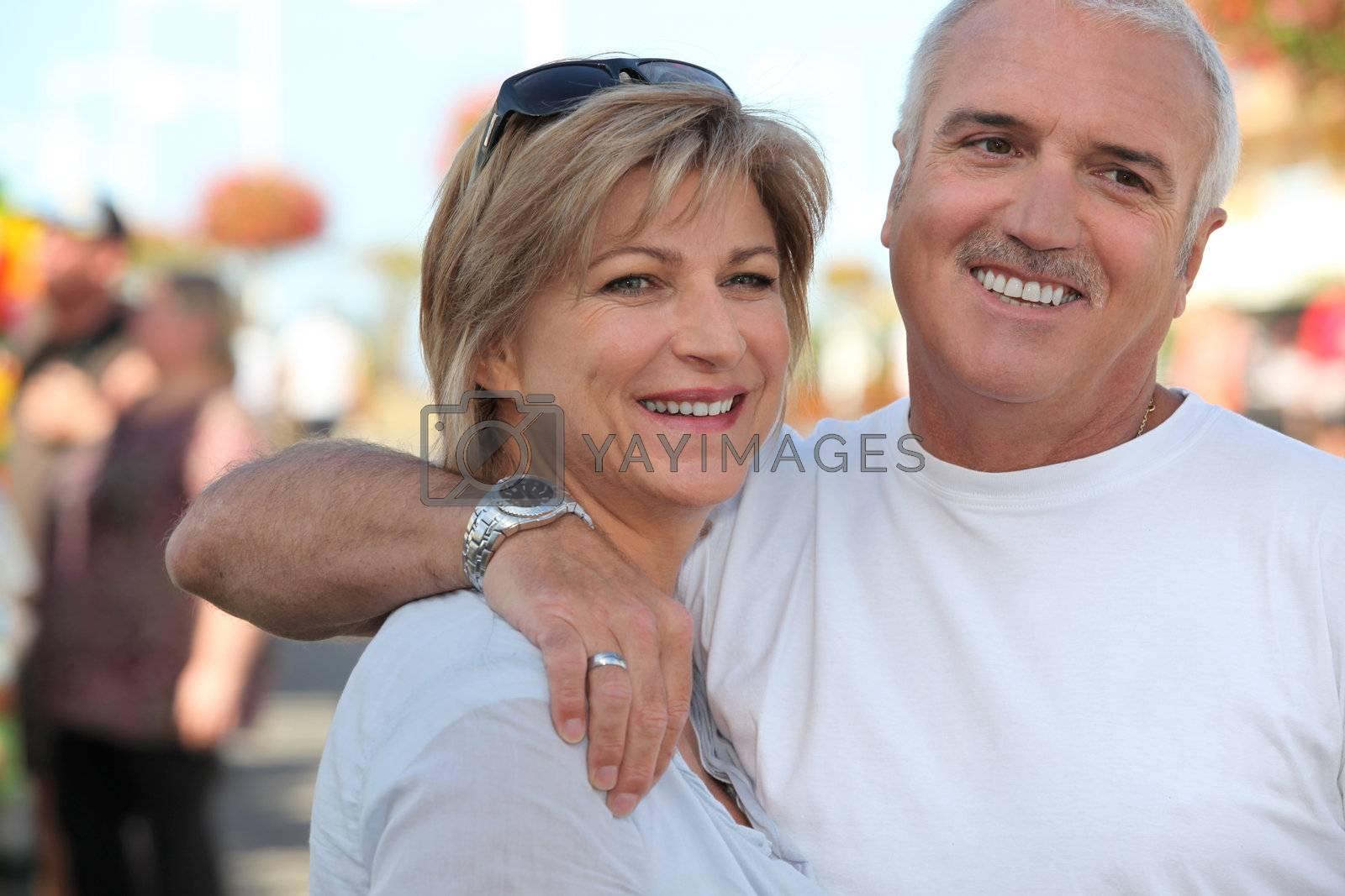 mature couple stood outdoors