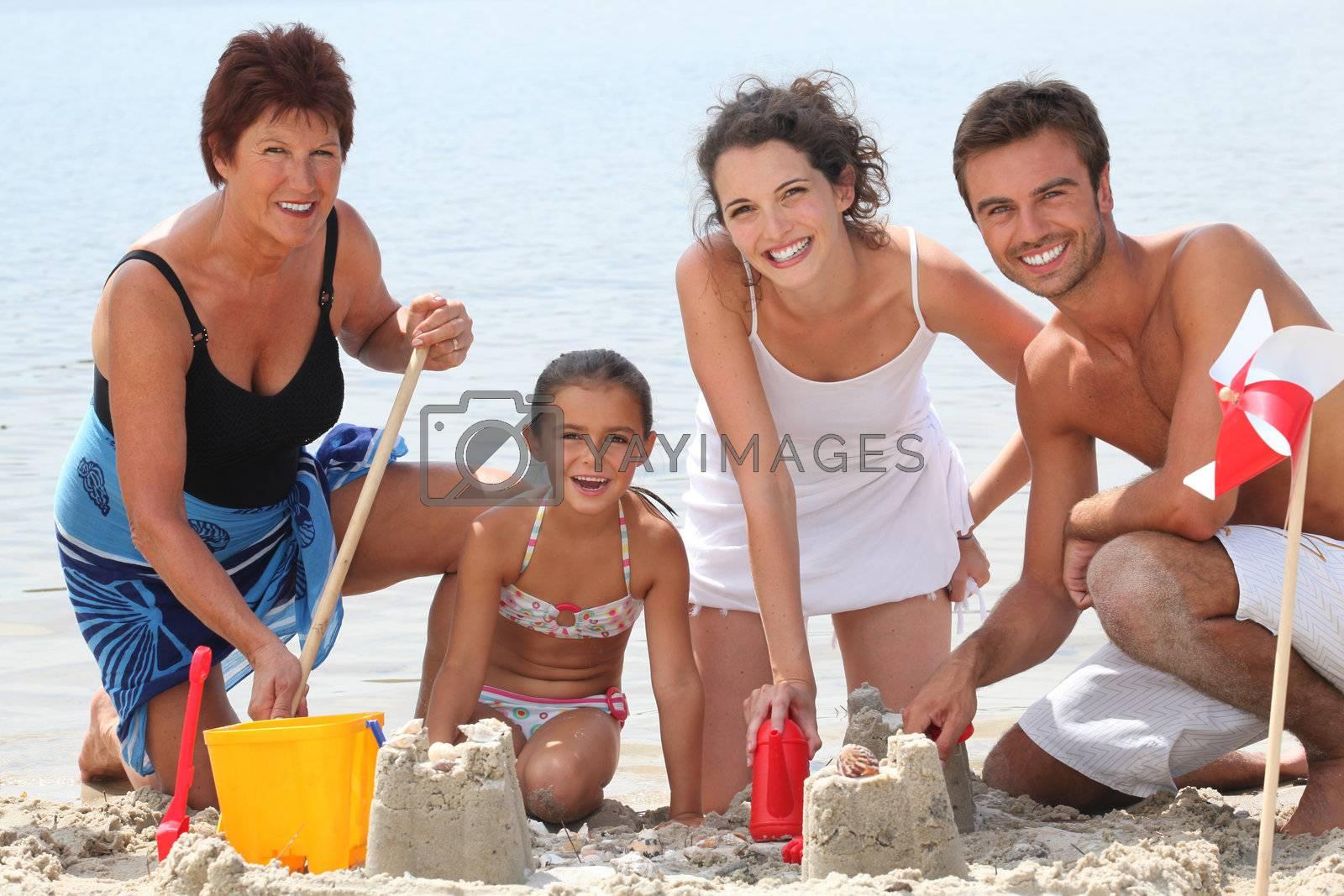 Family building sandcastles on the beach