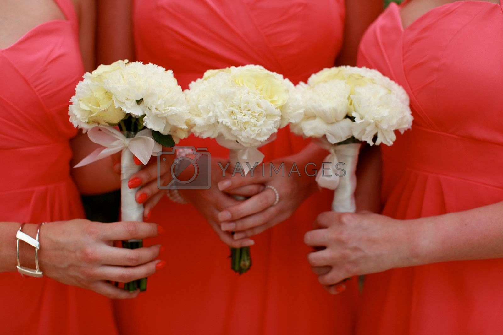 Close-up of bridesmaids holding their wedding bouquets.