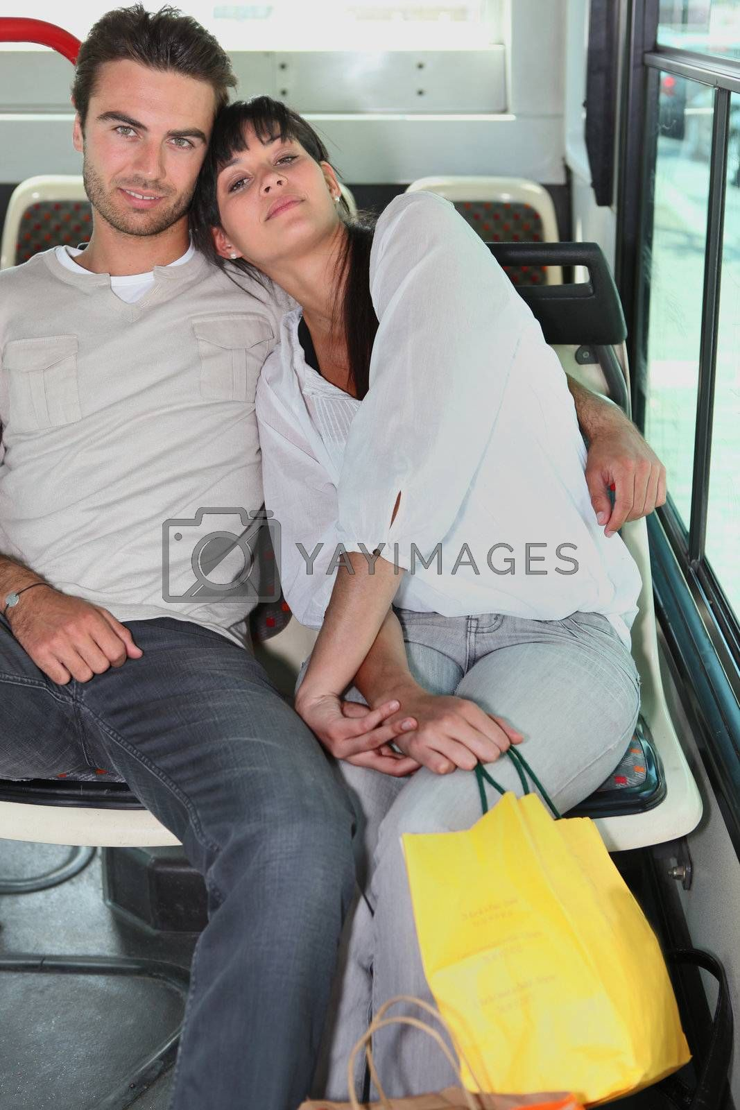 Couple embraced inside a bus