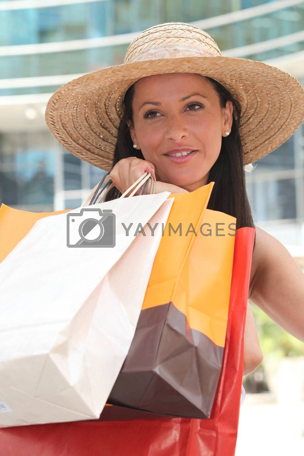 Young woman doing shopping by phovoir