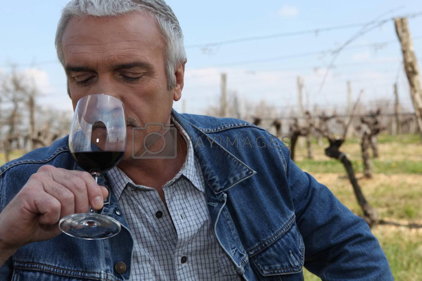 Man sniffing wine