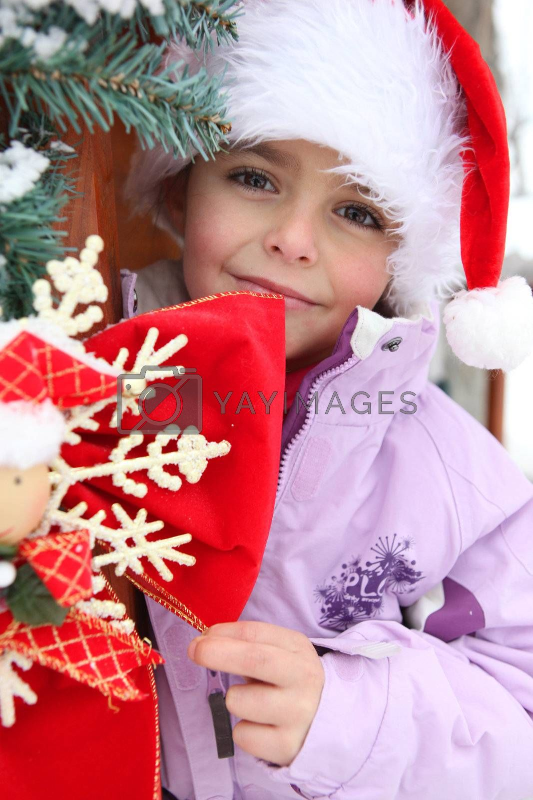 Little girl playing outside at Christmastime