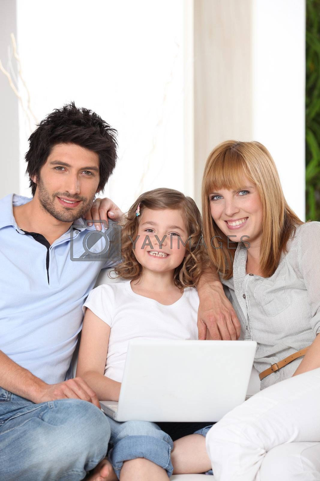 Family with a laptop by phovoir