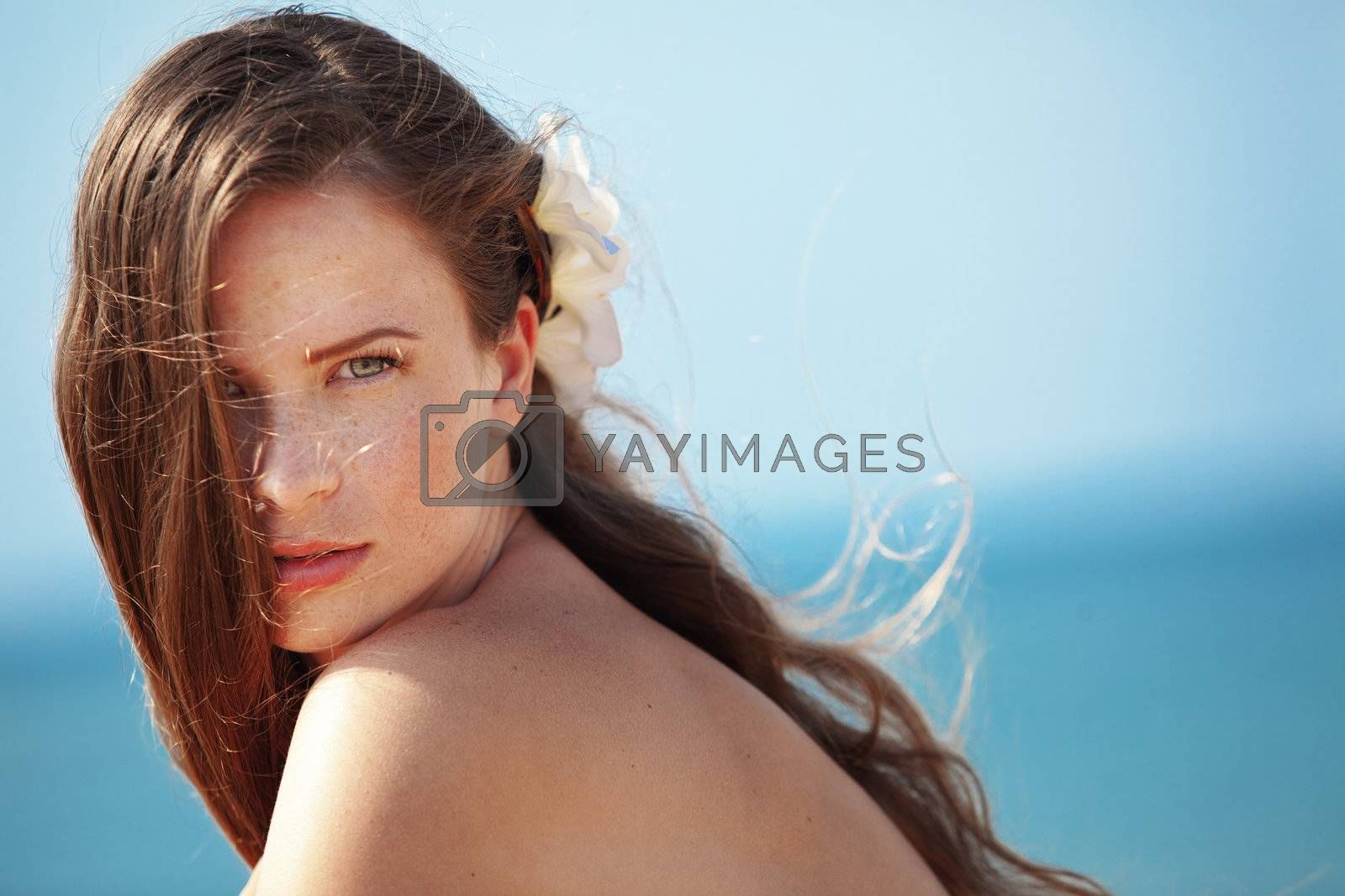 Portrait of very beautiful youg girl posing at the summer beach