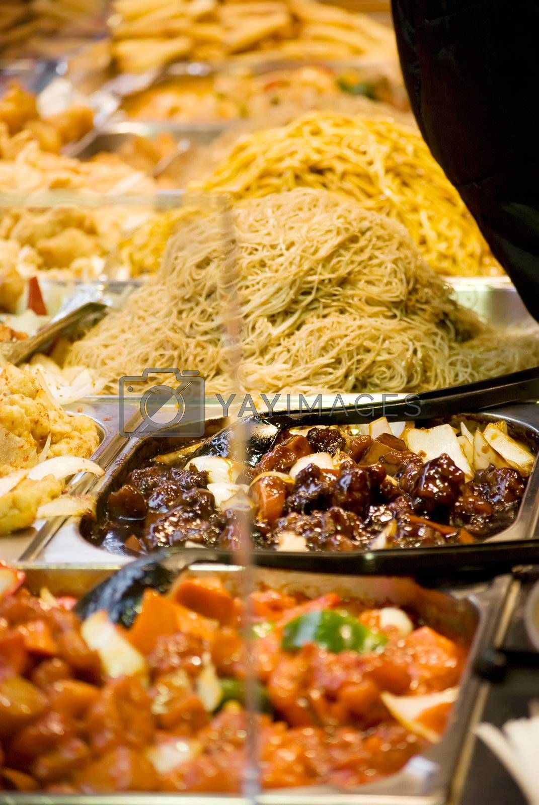 Freshly prepared oriental dishes on a market stall