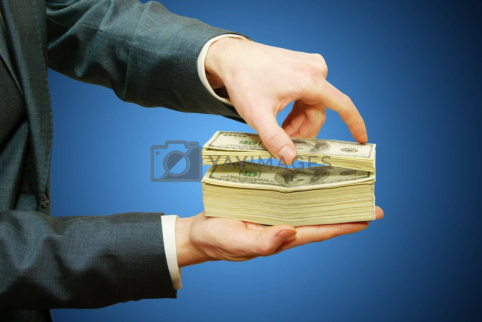 Hand with money isolated on blue background