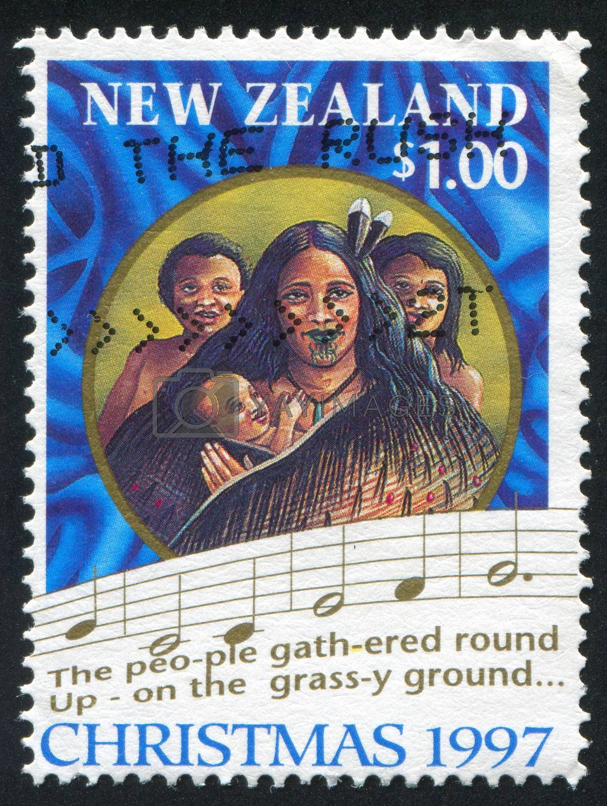 NEW ZEALAND - CIRCA 1997: stamp printed by New Zealand, shows Scenes from first Christian service, Rangihoua Bay, and words from Christmas carol, circa 1997