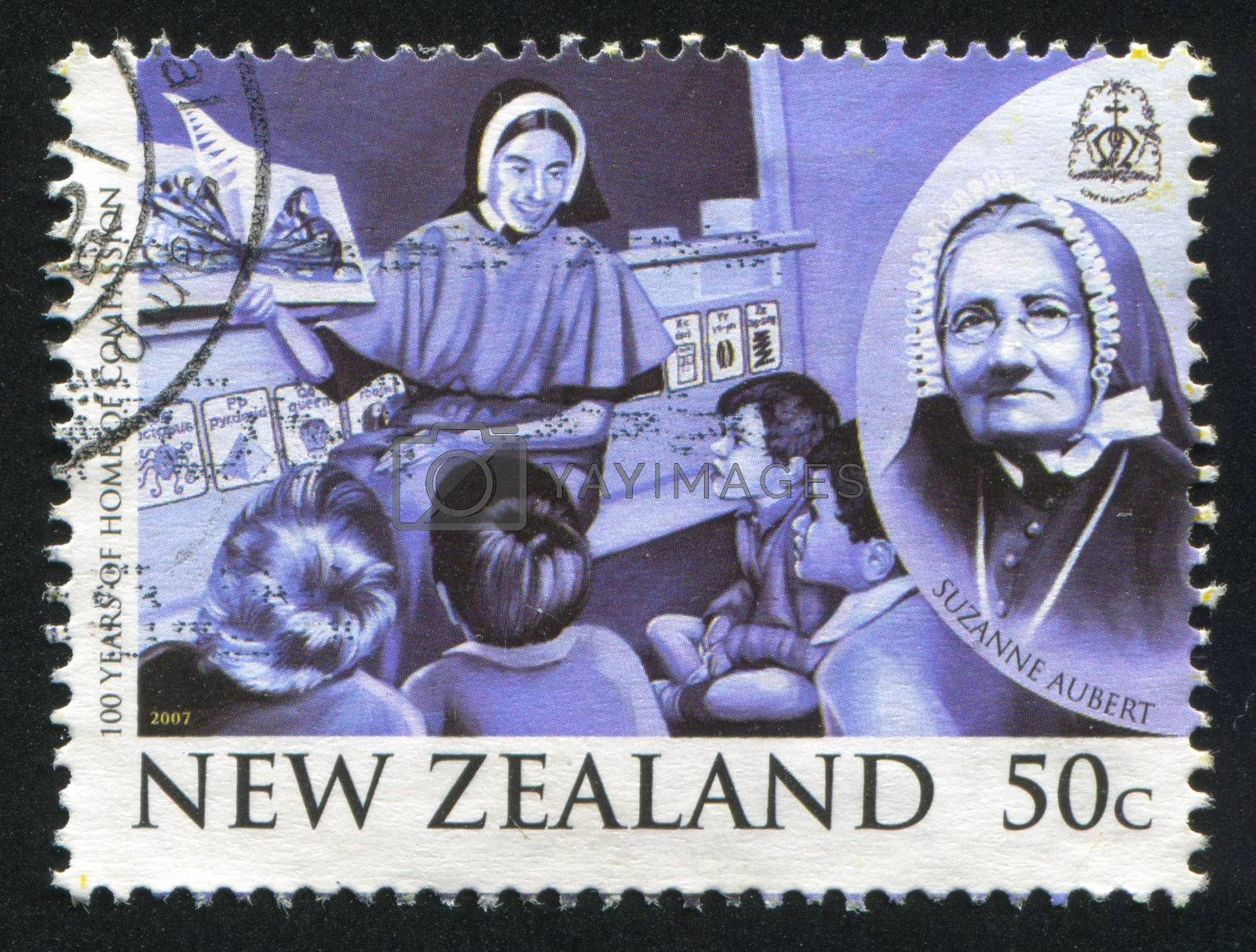 NEW ZEALAND - CIRCA 2007: stamp printed by New Zealand, shows Sister of Compassion Teaching Children, Suzanne Aubert, Founder of Sisters of Compassion, circa 2007