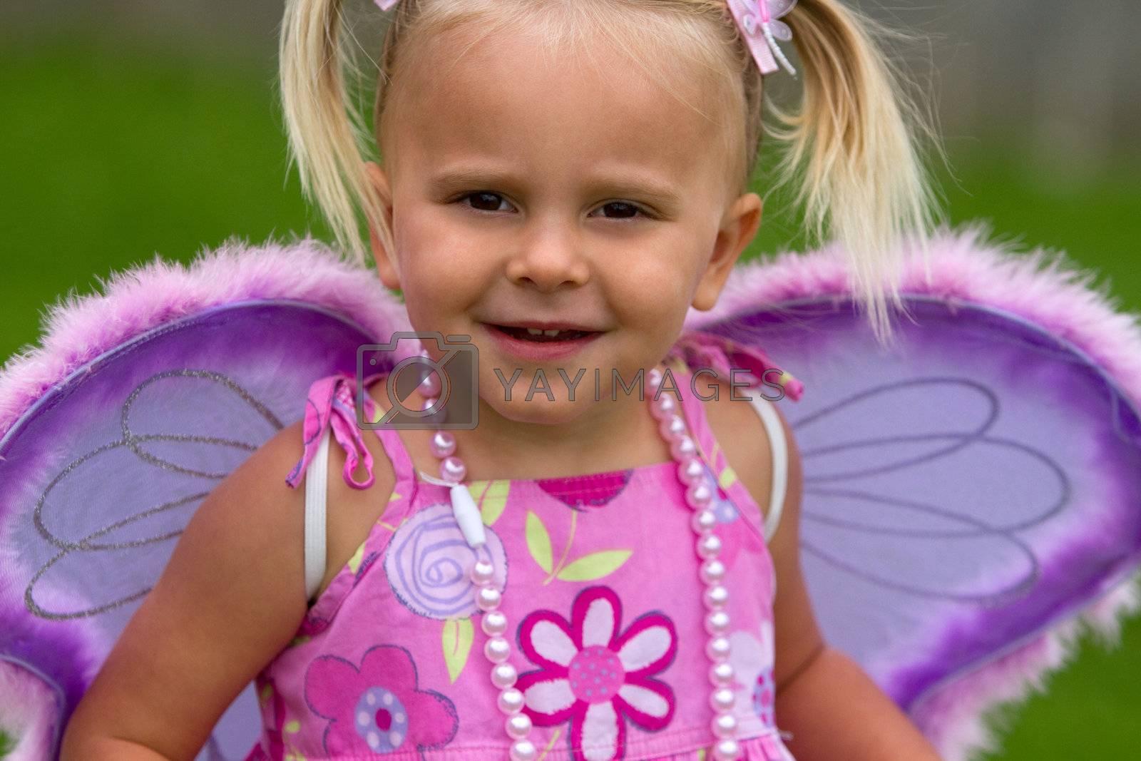 Beautiful little girl wearing wings