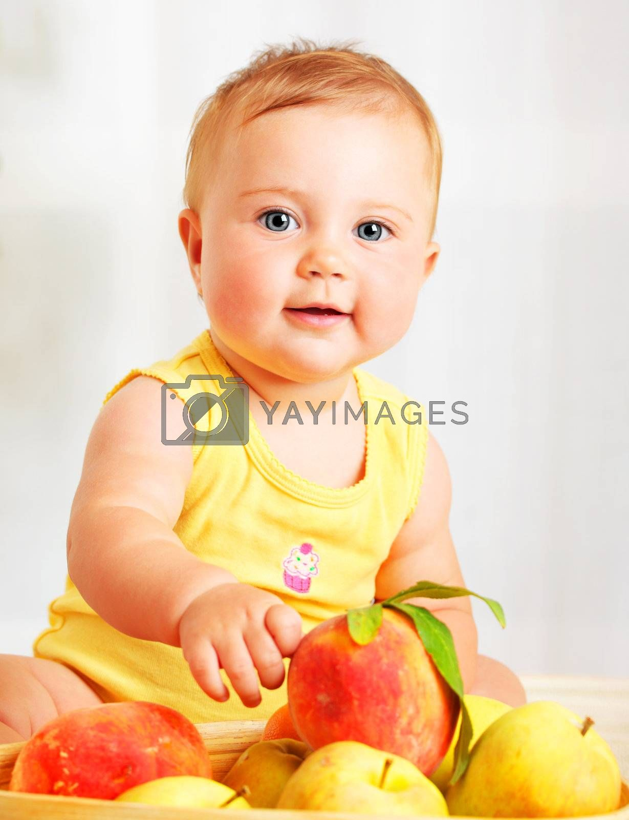 Little baby choosing fruits, closeup portrait, concept of health care & healthy child nutrition