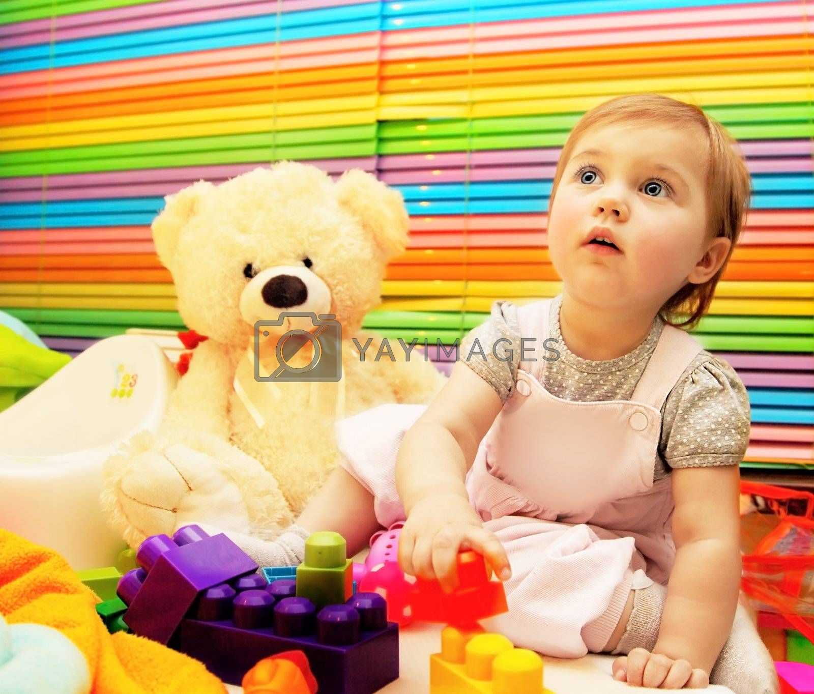 Little baby girl playing with colorful toy, child education concept